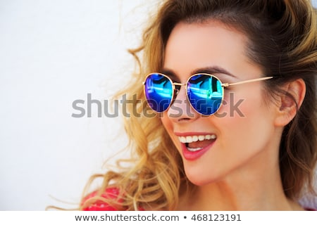 Photo closeup of beautiful young woman with curly hair in summer Stock photo © deandrobot