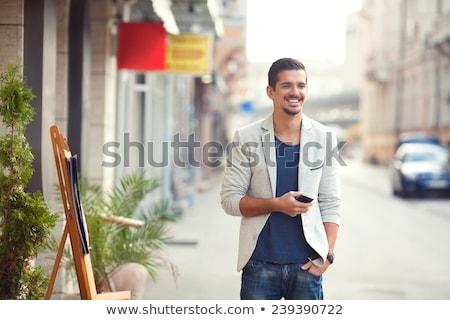 Młody człowiek stałego chodniku portret przystojny budynku Zdjęcia stock © AndreyPopov