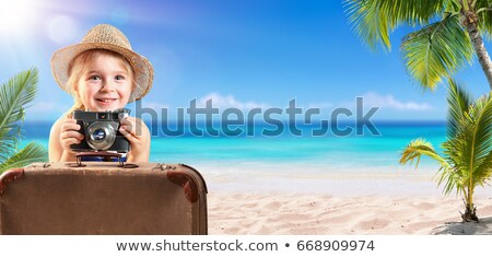 Children on the beach in luggage Stock photo © bluering