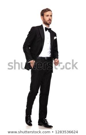 Meraklı işadamı siyah takım elbise yan yürüyüş Stok fotoğraf © feedough
