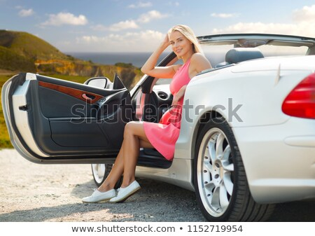 woman posing in convertible car at big sur coast Stock photo © dolgachov