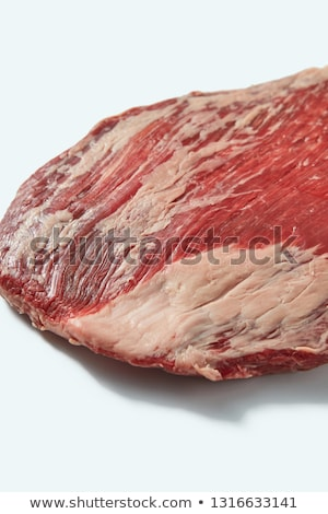Fresh organic natural raw flank steak, close up structure ob beef on a white background, copy space. Stock photo © artjazz