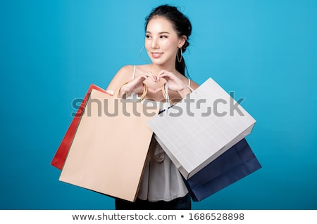 Young woman shopping happily in a fashion store Stock photo © lightpoet