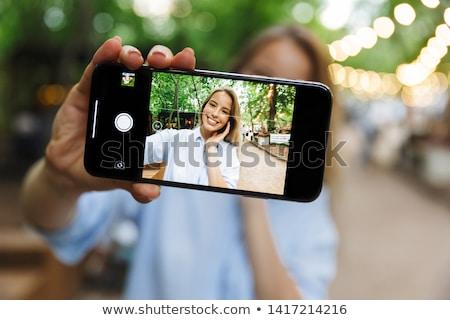 Elképesztő fiatal csinos nő park kint elvesz Stock fotó © deandrobot