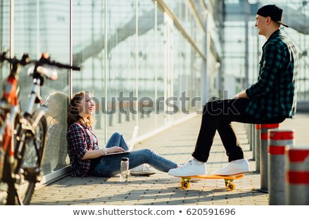 Two cheerful young girls on on roller skates spending time Stock photo © deandrobot