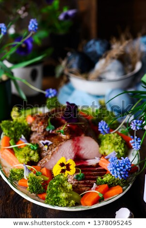 Turkey Breast Ham on the spring Easter background .style rustic. Stock fotó © zoryanchik