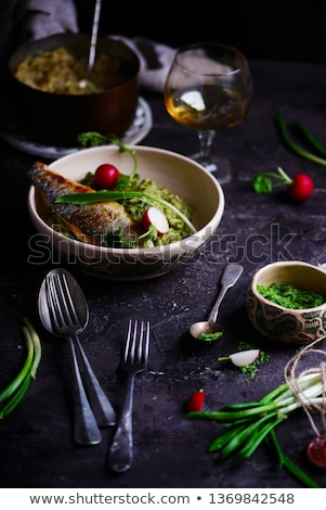 risotto with wild garlic and sea bass.style rustic. Stock photo © zoryanchik