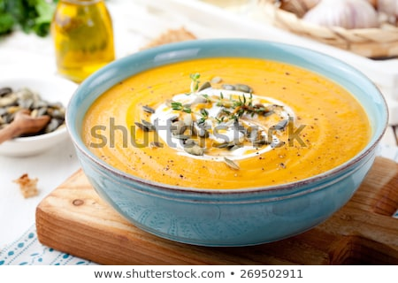 Cream of pumpkin soup on a white wooden background. Stock photo © Illia