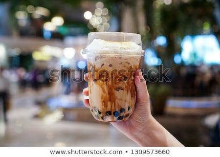 Man drinking cold bubble tea in cafe Stock photo © galitskaya