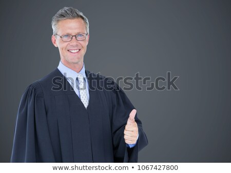 Male judge thumbs up against grey background Stock photo © wavebreak_media