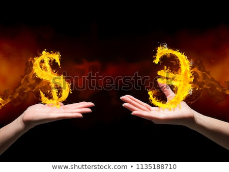 hand with euro fire icon over black background stock photo © wavebreak_media