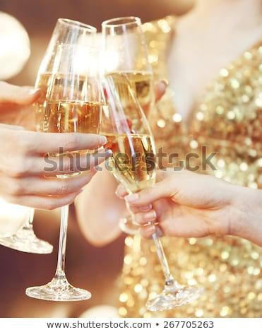 close up of couple clinking champagne glasses Stock photo © dolgachov