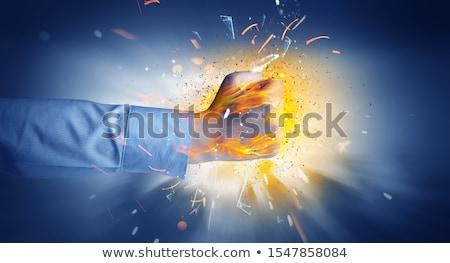 Hand hits intense and makes fire Stock photo © ra2studio