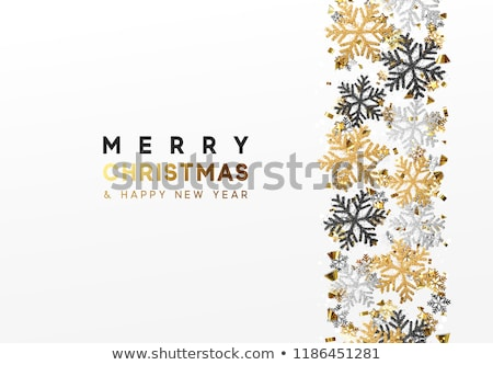 shining gold snowflakes on white background christmas and new year background vector illustration stock photo © olehsvetiukha