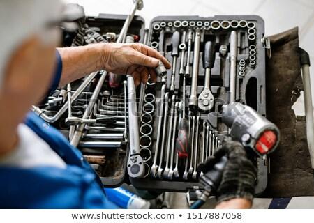 Kéz érett profi technikus választ fúvóka Stock fotó © pressmaster