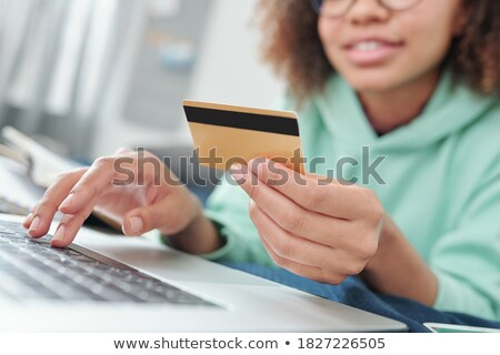 Hands of young woman over laptop keypad going to surf through online goods Stock photo © pressmaster