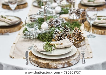 Holiday table setting with red napkin and silver cutlery, food s Stock photo © Anneleven