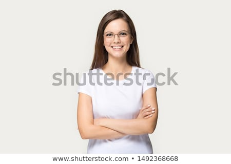 Image of pleased woman smiling and standing with arms crossed Stock photo © deandrobot