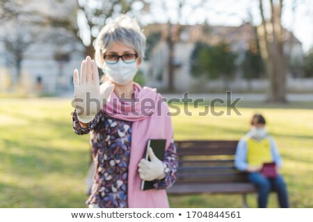 Grandmother giving stop sign to covid-19 protecting her grandson Stock photo © Kzenon