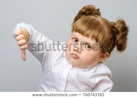 Young girl with thumbs down Stock photo © iko