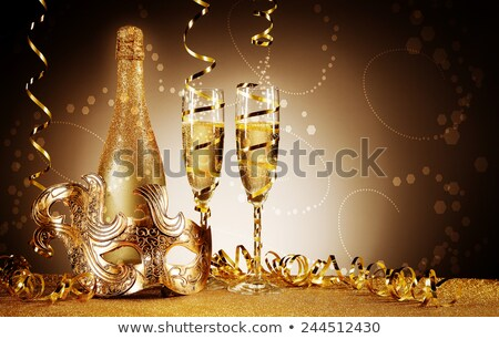 champagne in two glasses with streamers and carnival mask stock photo © dashapetrenko