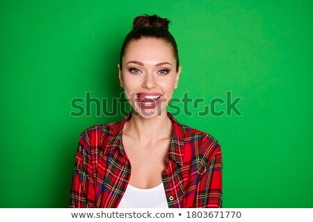 Close up woman licking her red teeth. Stock photo © RTimages