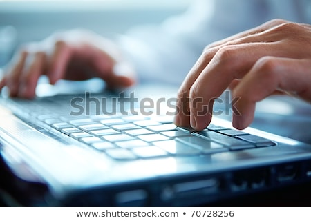 Close-up of typing male hands Stock photo © HASLOO