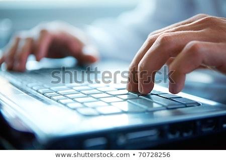Datilografia masculino mãos feminino mão Foto stock © HASLOO
