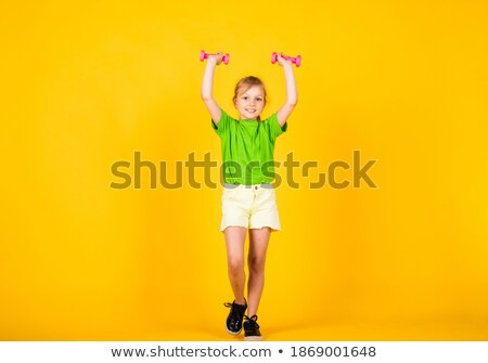 Pretty girl with barbells stock photo © Nobilior