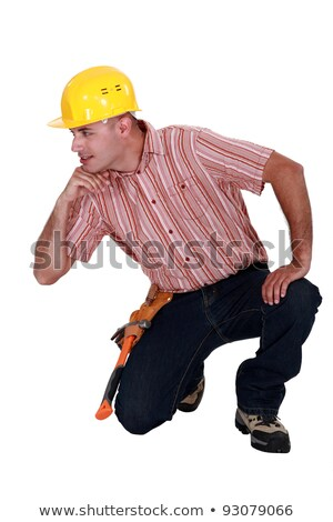 Tradesman with his elbow propped up on an invisible object Stock photo © photography33