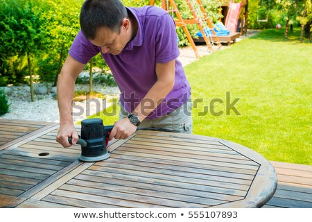 young man sanding furniture stock photo © photography33
