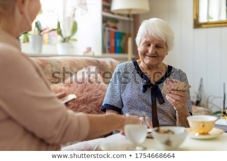 Stock photo: grandmother and daughter playing cards