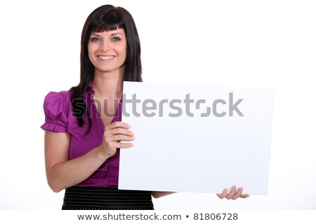 25 years old woman wearing a suit and showing a white panel stock photo © photography33