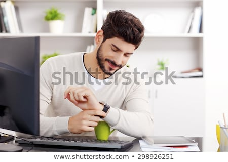 Office assistant looking at the time Stock photo © photography33