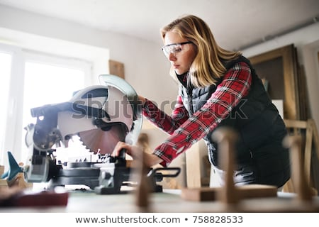 woman sawing plank of wood stock photo © photography33