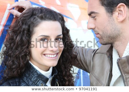 Couple stood by wall covered in graffiti Stock photo © photography33