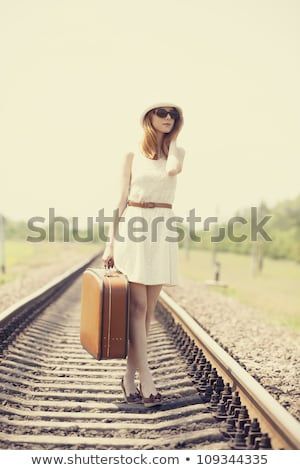 young fashion girl with suitcase at railways stock photo © massonforstock