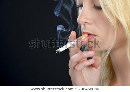 Sıkılmış sigara tiryakisi bo bakıyor adam sigara içme Stok fotoğraf © lisafx