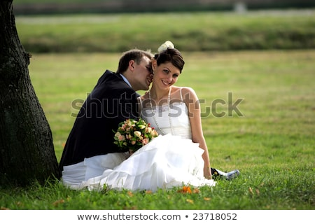 Happy couple sat under a tree Stock photo © photography33
