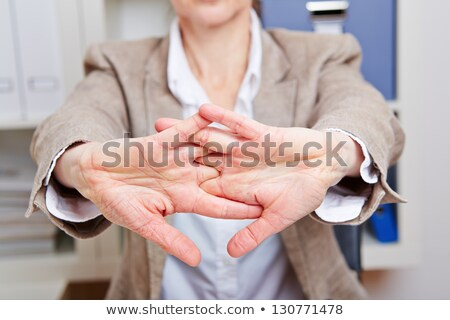 Businesswoman with hand stretched out Stock photo © photography33