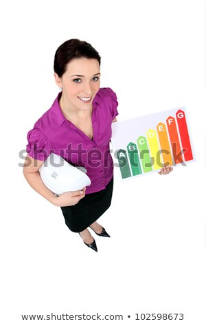 woman stood with energy rating board stock photo © photography33