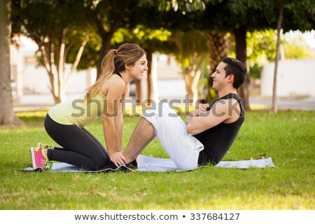 brunette and boyfriend doing exercise outdoors Stock photo © photography33