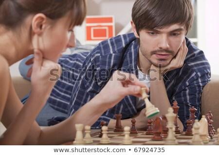 jugando · ajedrez · casa · mujer · familia - foto stock © photography33