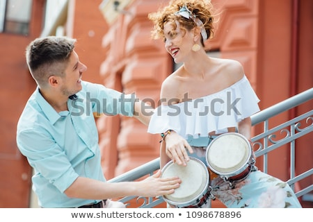 Couple playing a bongo drum Stock photo © photography33