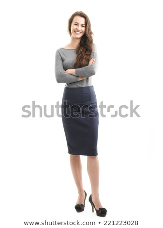 Confident young businesswoman looking at the camera against a white background stock photo © wavebreak_media