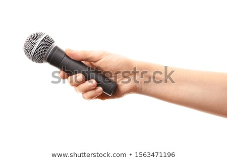 Stock photo: Hand holding microphone