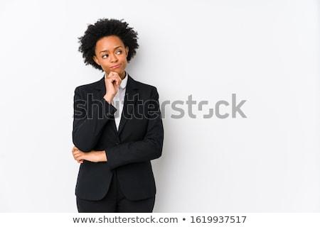 Thoughtful businesswoman against a white background Stock photo © wavebreak_media