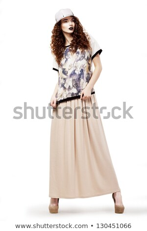 Modish Glamorous Woman in Fashion dress and Cap posing. Studio shot Stock photo © gromovataya