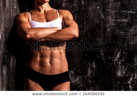 muscled woman against the scratched grunge background stock photo © nobilior