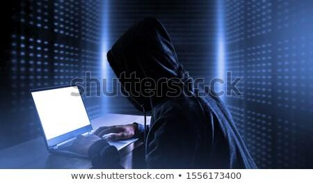Inbreker met behulp van laptop portret geïsoleerd witte computer Stockfoto © AndreyPopov
